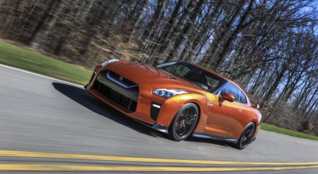 The 2017 GT-R's exterior receives a thorough makeover. The new V-motion grille, one of Nissan's latest design signatures, has been slightly enlarged to provide better engine cooling and now features a matte chrome finish and an updated mesh pattern. A new hood, featuring pronounced character lines flowing flawlessly from the grille, has been reinforced to enhance stability during high-speed driving. A freshly designed front spoiler lip and front bumpers with finishers situated immediately below the headlamps give the new GT-R the look of a pure-bred racecar, while generating high levels of front downforce.